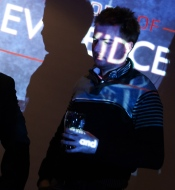 Not a scene from C.S.I.: Montreal, but Andrew Cody walking in front of The Body of Evidence logo